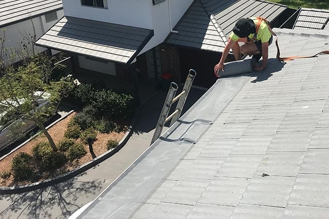 leaf gutter guard being installed